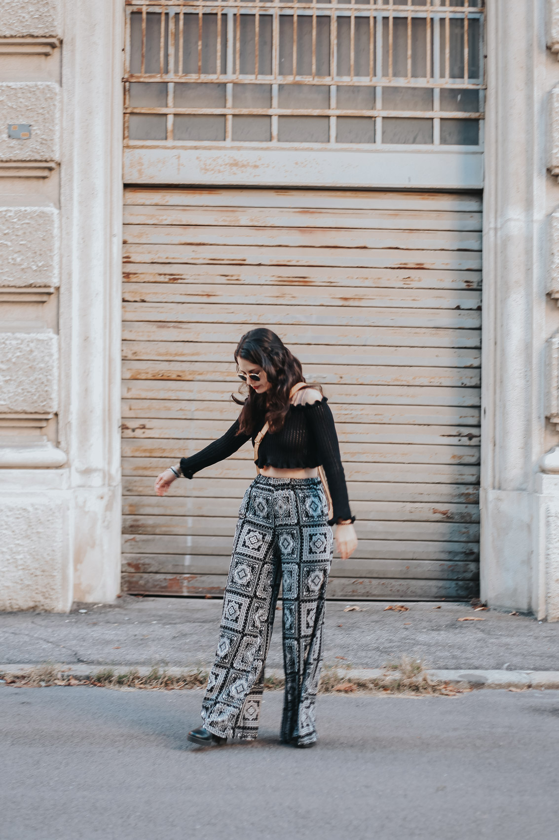 full body girl trying to pose naturally on a front door