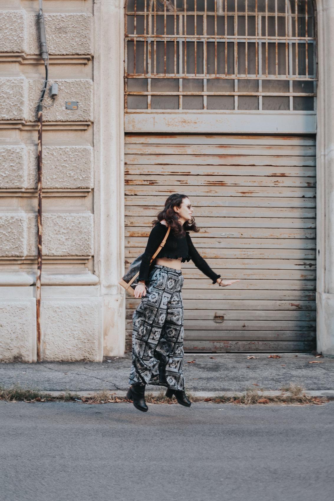 girl jumping with palazzo pants